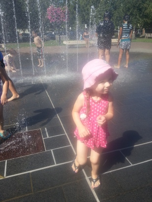 Playing in the fountains at a park.