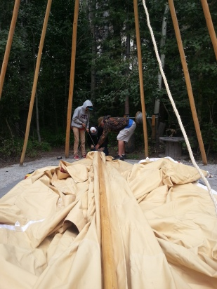 Putting up a tipi at the ropes course.